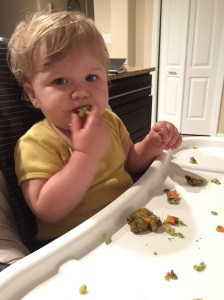 baby eating spinach patties